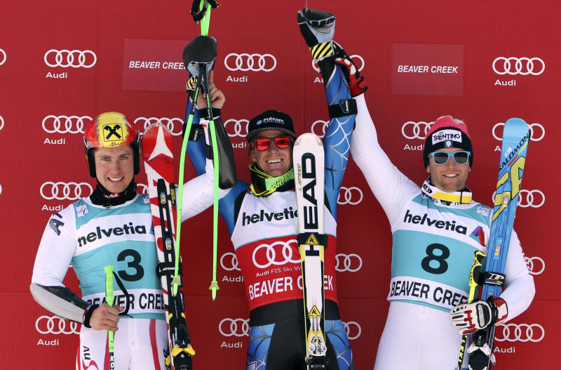 From left, second place finisher Marcel Hirscher, of Austria, winner Ted Ligety and third place finisher Davise Simoncelli, of Italy, react at the men's World Cup giant slalom ski race in Beaver Creek, Colo, Sunday, Dec. 2, 2012. (AP Photo/Alessandro Trovati)