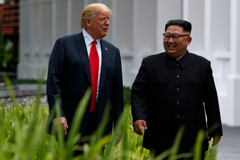 President Donald Trump walks with North Korean leader Kim Jong Un in Singapore on June 12.