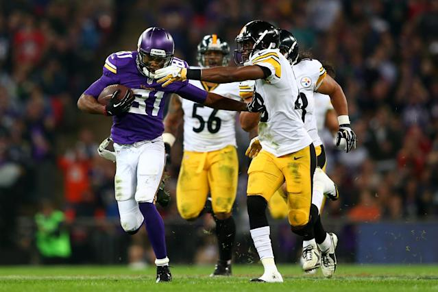 LONDON, ENGLAND - SEPTEMBER 29: Wide receiver Jerome Simpson #81 of the Minnesota Vikings is hauled back by cornerback Cortez Allen #28 of the Pittsburgh Steelers during the NFL International Series game between Pittsburgh Steelers and Minnesota Vikings at Wembley Stadium on September 29, 2013 in London, England. (Photo by Michael Steele/Getty Images)
