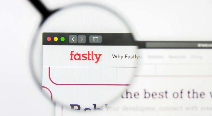 A magnifying glass zooms in on the Fastly (FSLY) website.