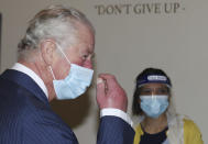 Britain's Prince Charles during a visit to an NHS vaccine pop-up clinic at Jesus House church, London, Tuesday March 9, 2021, where he has been told about work to combat vaccine hesitancy and support for the community during the coronavirus pandemic. (Ian Vogler/Pool via AP)