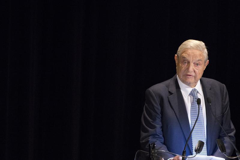 George Soros speaks on stage at the Annual Freedom Award Benefit Event hosted by the International Rescue Committee at the Waldorf-Astoria in New York