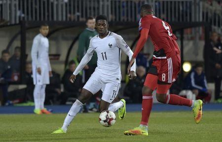 France's Ousmane Dembele in action with Luxembourg's Christopher Martins Pereira
