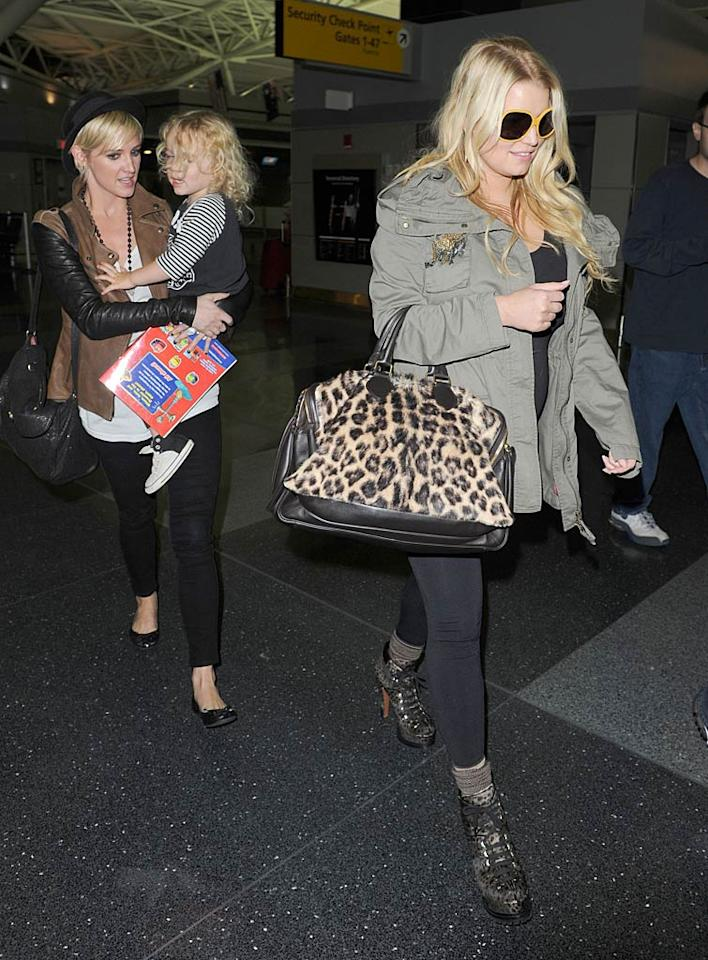 Later that day, Jess was snapped walking through JFK International Airport with her sister, Ashlee, and adorable nephew Bronx. We're sure Bronx -- who turns 3 on November 20 -- wouldn't mind having a little cousin to play with!  (10/23/2011)