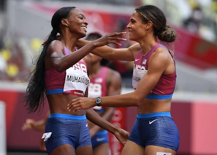 """American Sydney McLaughlin, right, celebrates her gold medal with silver medalist and teammate Dalilah Muhammed after the 400m hurdles at the 2020 Tokyo Olympics.<span class=""""copyright"""">Wally Skalij–Los Angeles Time/Getty Images</span>"""