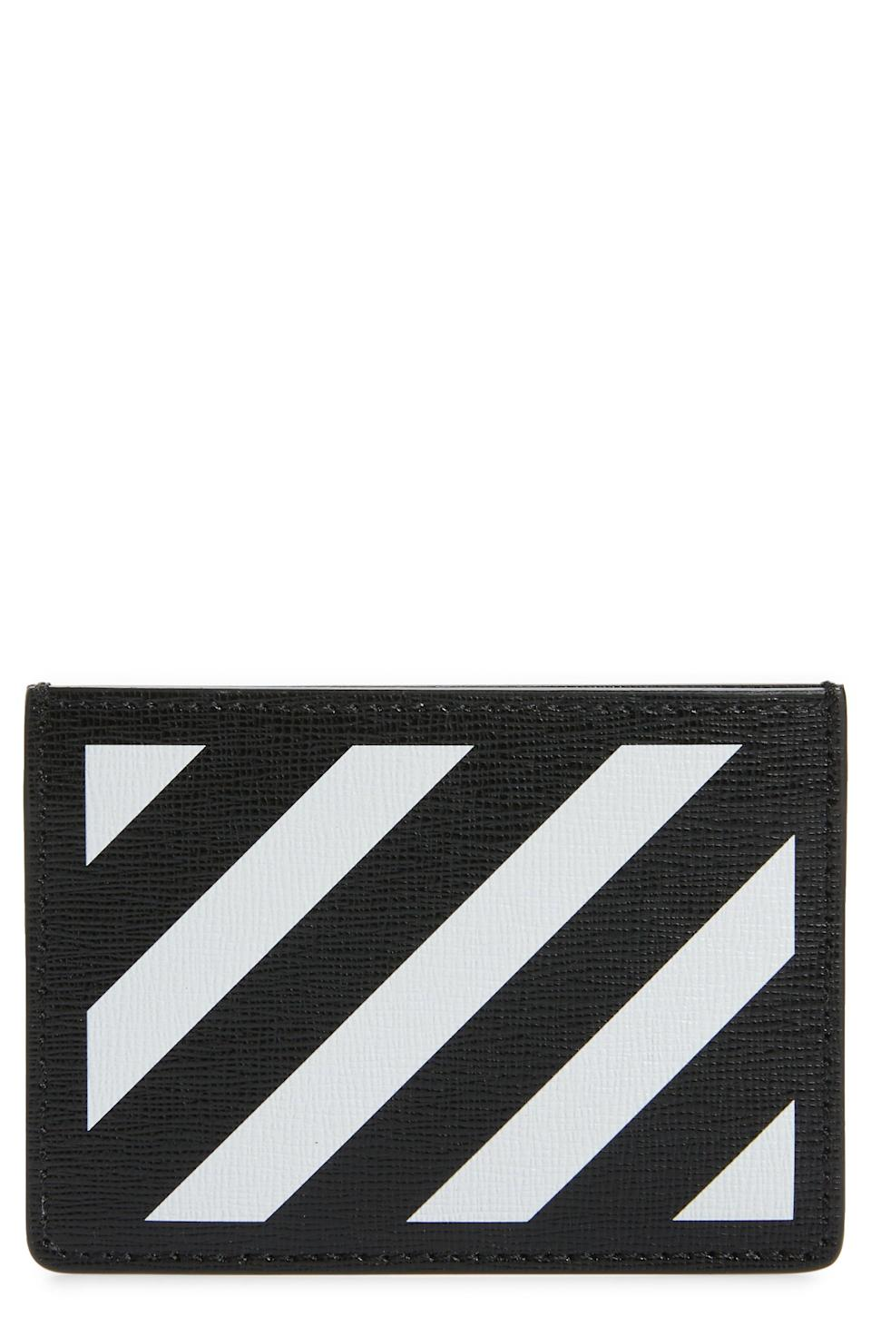 """<p><strong>Off-White</strong></p><p>nordstrom.com</p><p><strong>$275.00</strong></p><p><a href=""""https://go.redirectingat.com?id=74968X1596630&url=https%3A%2F%2Fwww.nordstrom.com%2Fs%2Foff-white-diagonal-stripe-card-wallet%2F5874721&sref=https%3A%2F%2Fwww.esquire.com%2Fstyle%2Fmens-accessories%2Fg35924710%2Fmens-luxury-wallets%2F"""" rel=""""nofollow noopener"""" target=""""_blank"""" data-ylk=""""slk:Shop Now"""" class=""""link rapid-noclick-resp"""">Shop Now</a></p><p>Or, to Abloh-ize it: """"WALLET."""" </p>"""