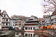 """A blend of French and German cultures (it's located right near the border with Germany), it's only natural that <a href=""""https://www.cntraveler.com/stories/2015-10-07/the-essential-guide-to-alsace-france?mbid=synd_yahoo_rss"""" rel=""""nofollow noopener"""" target=""""_blank"""" data-ylk=""""slk:Strasbourg"""" class=""""link rapid-noclick-resp"""">Strasbourg</a> stuns in the winter months. Nearby Colmar, whose charming canal area is called La Petite Venise (little Venice) makes the perfect winter day trip, and is especially scenic when covered in a blanket of snow. Grey skies are more common than snowfall in France's Alsace region, but we say it's charming no matter the weather. Strasbourg's Christmas markets are renowned (they were first held here in the 16th century)—causing the scent of mulled wine and bredele cookies to waft through the streets. The brilliant hanging lights that illuminate the city's centerpiece, the Cathédrale Notre Dame de Strasbourg, are also a sight to behold."""