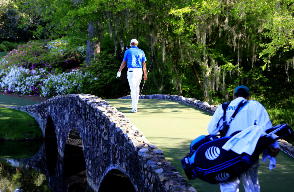 Jordan Spieth with a lonely walk across Nelson Bridge in 2016. (Rob Brown/Augusta National via Getty Images)