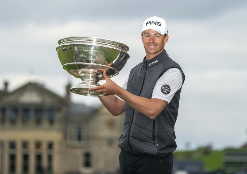 Victor Perez shows off the trophy following his win of the Links Championship at St Andrews in Scotland, Sunday Sept. 29, 2019. (Kenny Smith/PA via AP)