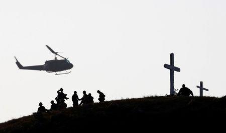 "A Philippine military helicopter hovers above Filipino soldiers during a military exercise with U.S. troops called ""Balikatan"" (shoulder-to-shoulder) in Capas"