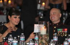 Mila Kunis attends the Marine Corps Ball in Greenville, N.C. with Sgt. Scott Moore -- Cpl. Johnny Merkley