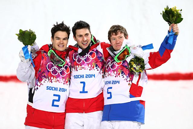 SOCHI, RUSSIA - FEBRUARY 10: (L-R) Silver medalist Mikael Kingsbury of Canada, gold medalist Alex Bilodeau of Canada and Alexandr Smyshlyaev of Russia celebrate on the podium during the flower ceremony for the Men's Moguls Finals on day three of the Sochi 2014 Winter Olympics at Rosa Khutor Extreme Park on February 10, 2014 in Sochi, Russia. (Photo by Cameron Spencer/Getty Images)