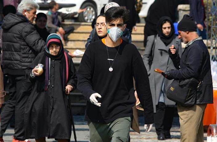 The COVID-19 outbreak has claimed the lives of eight people in the Islamic republic since Wednesday, the first deaths from the disease in the Middle East (AFP Photo/ATTA KENARE)