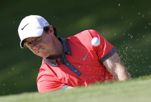 Rory McIlroy, of Northern Ireland, hits out of a bunker on the 18th hole during the first round of the Memorial golf tournament Thursday, May 29, 2014, in Dublin, Ohio. (AP Photo/Jay LaPrete)