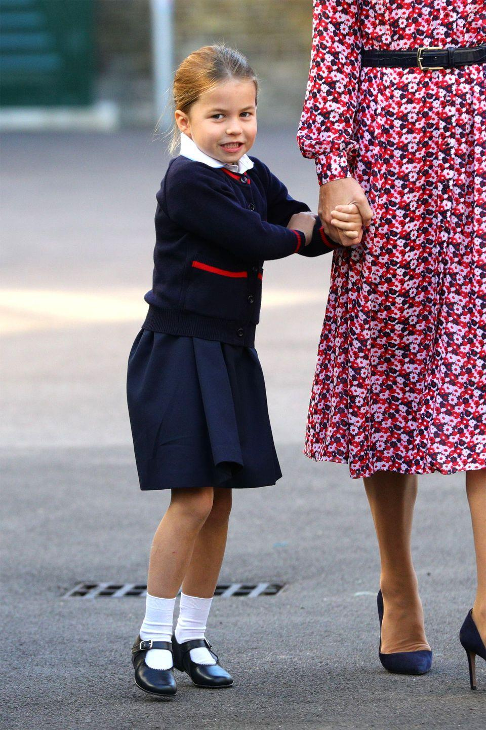 "<p>Charlotte clings onto her mother's hand as they draw nearer to Thomas's Battersea. Soon after, Kate <a href=""https://www.harpersbazaar.com/celebrity/latest/a28925140/kate-middleton-princess-charlotte-school-advice/"" rel=""nofollow noopener"" target=""_blank"" data-ylk=""slk:was heard"" class=""link rapid-noclick-resp"">was heard</a> giving her some encouraging advice. </p>"