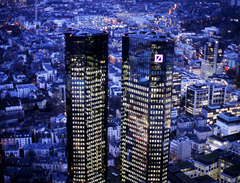 FILE - In this Thursday, Feb. 1, 2018 file photo the towers of the Deutsche Bank are seen in Frankfurt, Germany. The bank announced today a net profit of 341 million euros ($390 million) in 2018, the first after three straight years of losses. (AP Photo/Michael Probst)