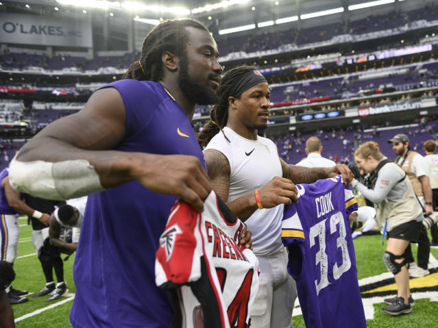Dalvin Cook of the Minnesota Vikings and Devonta Freeman of the Atlanta Falcons exchange jerseys after a game. Both players went to Miami Central High School. (Photo by Stephen Maturen/Getty Images)