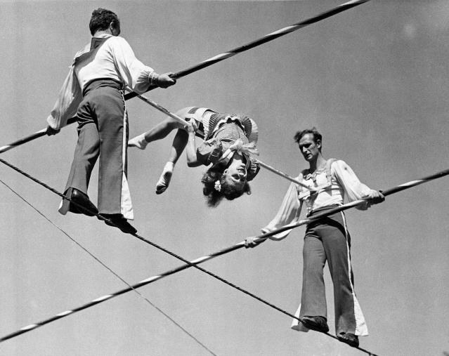 """FILE- In this March 19, 1944 photo, members of the Wallenda family practice on a 90 foot high wire at the Ringling Bros. and Barnum & Bailey's winter headquarters in Sarasota, Fla. On Friday, June 15, 2012, Nik Wallenda, a seventh generation """"Flying Wallenda,"""" will attempt a high-wire crossing of the Niagra Falls gorge between the United States and Canada. The event will be covered on live television. (AP Photo)"""