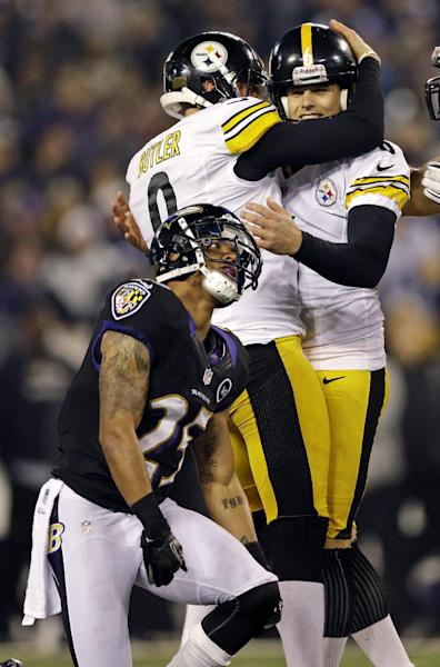 Pittsburgh Steelers kicker Shaun Suisham, right, is hugged by Drew Butler, left, after making the winning field goal during the second half of an NFL football game against the Baltimore Ravens in Baltimore, Sunday, Dec. 2, 2012. Baltimore. Ravens cornerback Asa Jackson looks past following the play. The Steelers won 23-20. (AP Photo/Patrick Semansky)
