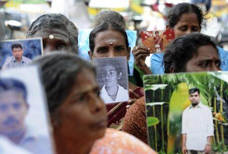Sri Lankan Tamils hold pictures of family members who disappeared during the war against the LTTE at a protest in Jaffna