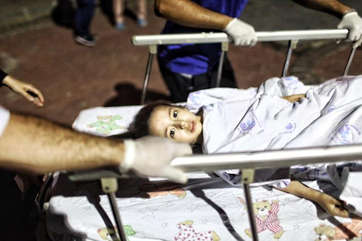 <p>A wounded girl from the Ataturk Airport suicide bomb attack is carried to the Bakirkoy Sadi Konuk Hospital, in the early hours of June 29, 2016 in Istanbul, Turkey. (Defne Karadeniz/Getty Images) </p>