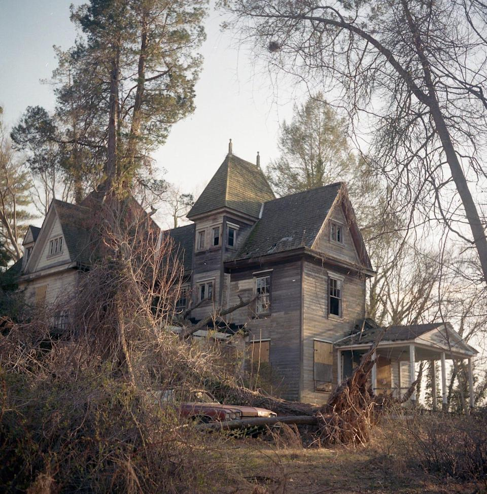 The exterior of an abandoned house.