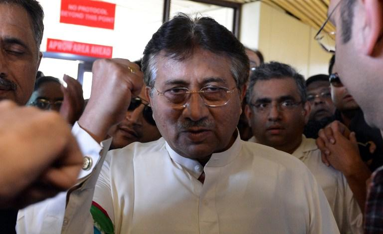 Pakistan's former military ruler Pervez Musharraf (C) gestures upon his arrival at the Karachi International airport from Dubai, in Karachi on March 24, 2013. Pakistan's former military ruler Pervez Musharraf returned home after more than four years in exile, defying a Taliban death threat to contest historic general elections. AFP PHOTO/ AAMIR QURESHI