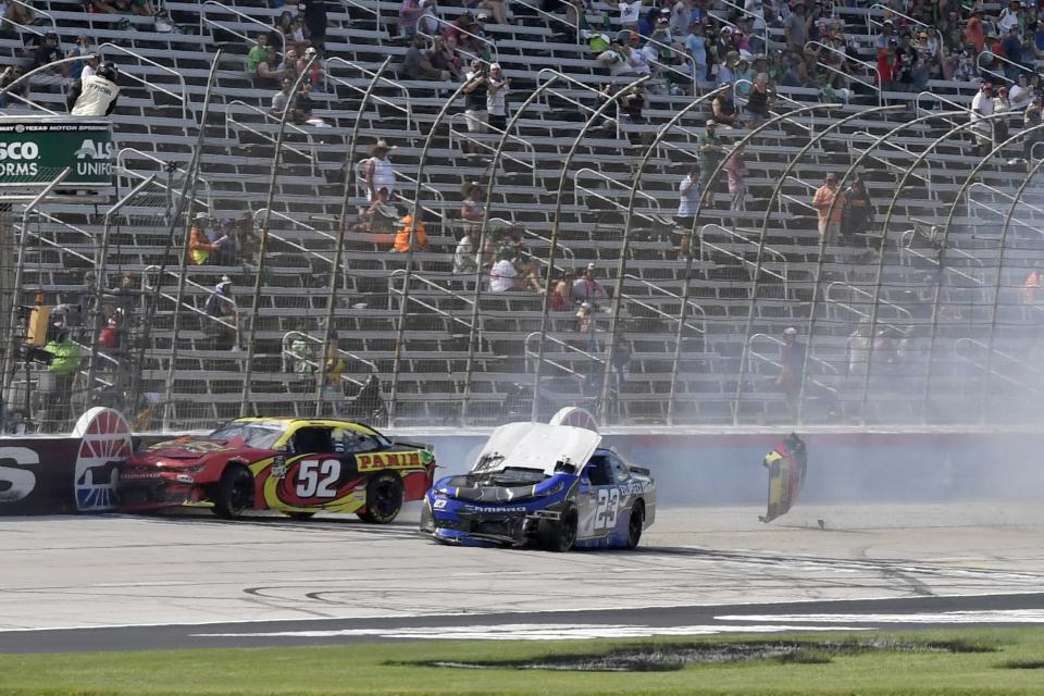 Gray Gaulding (52) and Tanner Berryhill (23) crash on the front stretch during a NASCAR Xfinity Series auto race at Texas Motor Speedway in Fort Worth, Texas, Saturday, June 12, 2021. (AP Photo/Larry Papke)