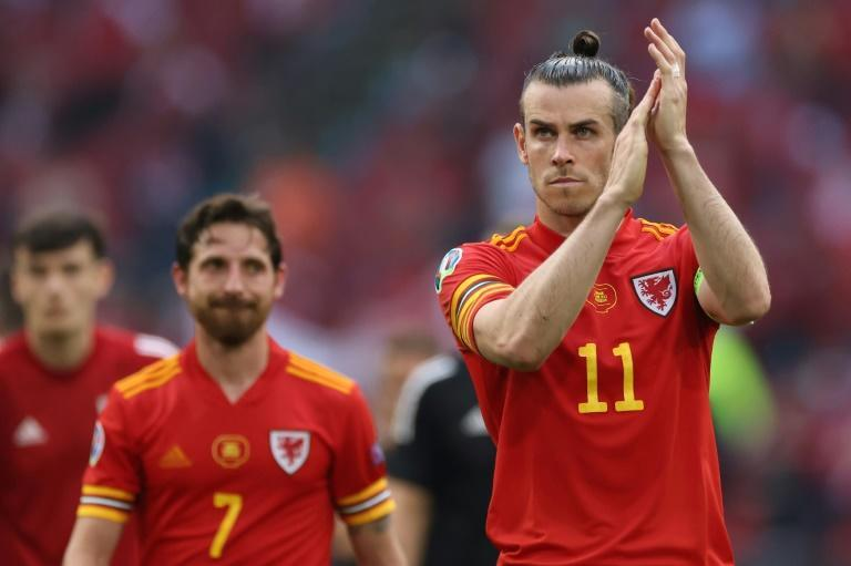 All over: Wales skipper Gareth Bale applauds fans after the loss to Denmark at Euro 2020