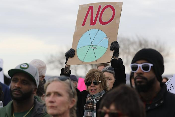 Protesters rally at Liberty State Park to support the Liberty State Park Protection Act and protest any proposed amendment allowing for the privatization of Caven Point Natural Area.