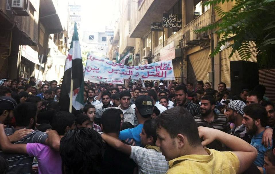 "In this citizen journalism image provided by Shaam News Network SNN, taken on Friday, July 13, 2012, Syrians chant slogans during a demonstration in Damascus, Syria. On Sunday Syria denied U.N. claims that government forces used heavy weapons during a military operation that left scores dead. Partial translation of Arabic on the banner reads, ""a horrible regime, killing and destruction."" (AP Photo/Shaam News Network, SNN)THE ASSOCIATED PRESS IS UNABLE TO INDEPENDENTLY VERIFY THE AUTHENTICITY, CONTENT, LOCATION OR DATE OF THIS CITIZEN JOURNALIST IMAGE"