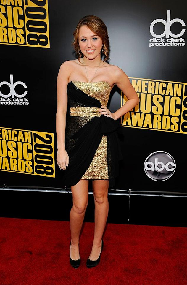 "Miley Cyrus celebrated her 16th birthday yet again at the AMAs in a fun gold and black frock. Frank Micelotta/<a href=""http://www.gettyimages.com/"" target=""new"">GettyImages.com</a> - November 23, 2008"