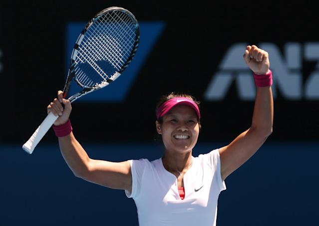 Li Na of China celebrates after defeating Eugenie Bouchard of Canada during their semifinal at the Australian Open tennis championship in Melbourne, Australia, Thursday, Jan. 23, 2014.(AP Photo/Aaron Favila)
