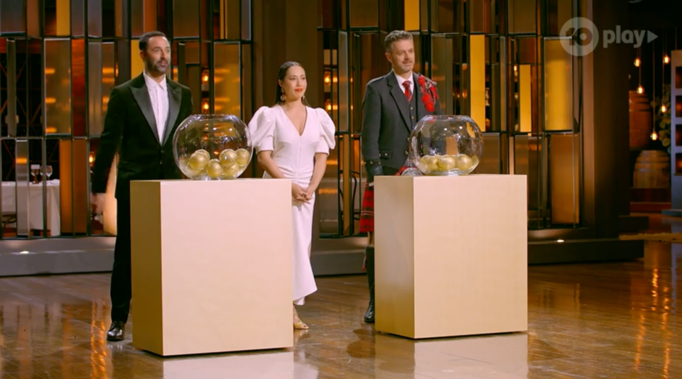 MasterChef judges with two bowls of golden balls.