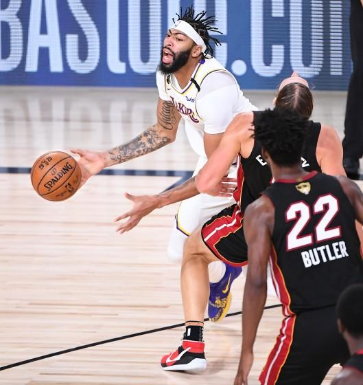Lakers forward Anthony Davis commits a foul by charging into Heat center Kelly Olynyk during Game 3 on Sunday night.