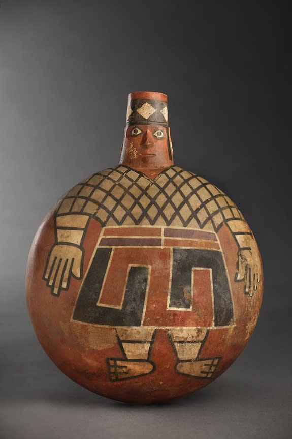 With eyes wide open, a painted Wari lord stares out from the side of a 1,200-year-old ceramic flask found in a newly discovered tomb at El Castillo de Huarmey in Peru. The Wari forged South America's earliest empire between A.D. 700 and 1000.