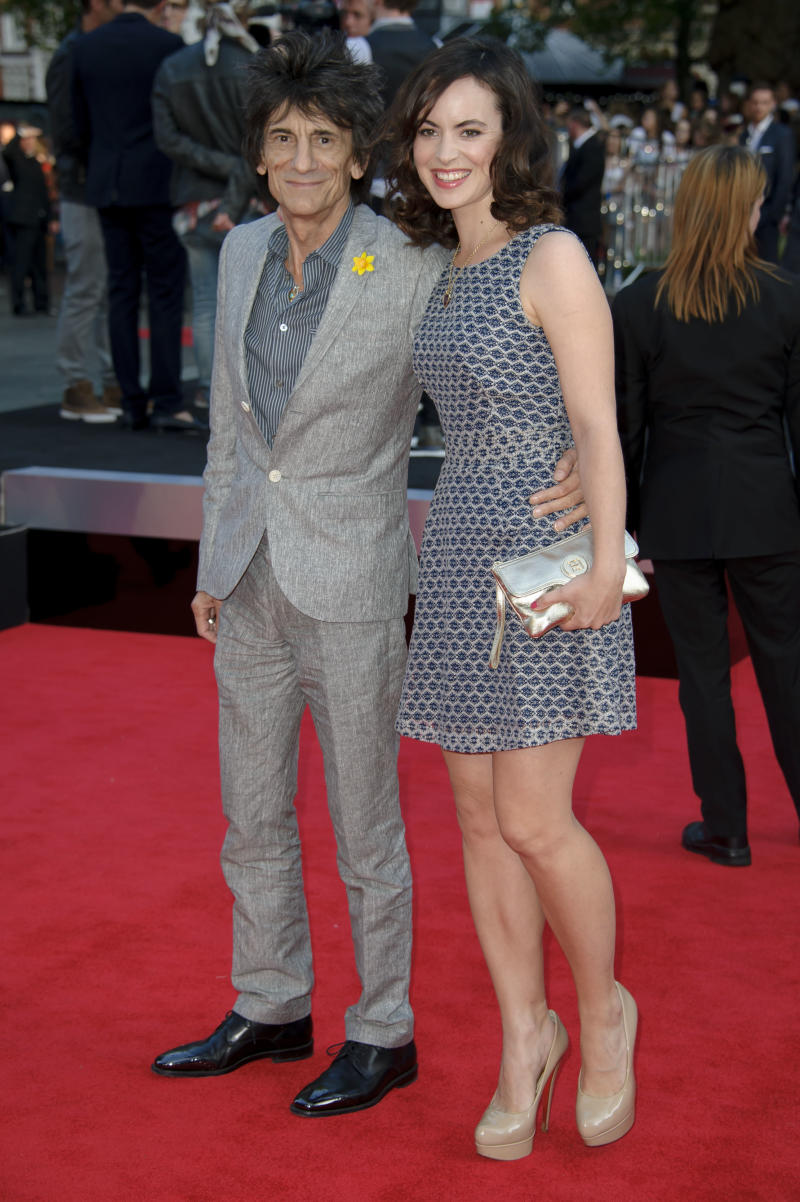 British musician Ronnie Wood and Sally Humphreys arrive for the UK Premiere of 'One Direction: This Is Us 3D' at a central London cinema, Tuesday, Aug. 20, 2013. (Photo by Jonathan Short/Invision/AP)