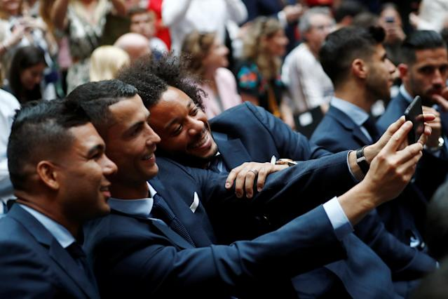 Soccer Football - Real Madrid celebrate winning the Champions League Final - Madrid, Spain - May 27, 2018 Real Madrid's Cristiano Ronaldo takes a selfie with Casemiro and Marcelo REUTERS/Javier Barbancho