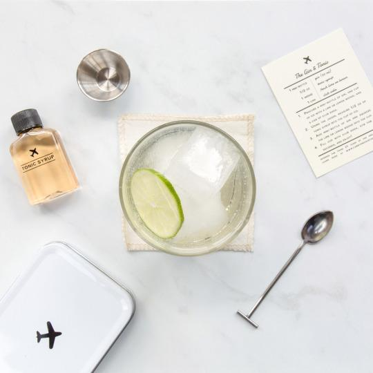 "<p>Upgrade your booze and mix your own <a href=""http://wandpdesign.com/pages/carryoncocktailkit"">Old Fashioned, gin and tonic, or Moscow mule</a> right in your airplane seat with this portable drink mix kit. Each includes a recipe card, .5 ounce jigger, bar spoon, and linen coaster. The Old Fashioned includes bitters and cane sugar; the Moscow Mule features small-batch ginger syrup; the gin and tonic offers a craft tonic.</p>"