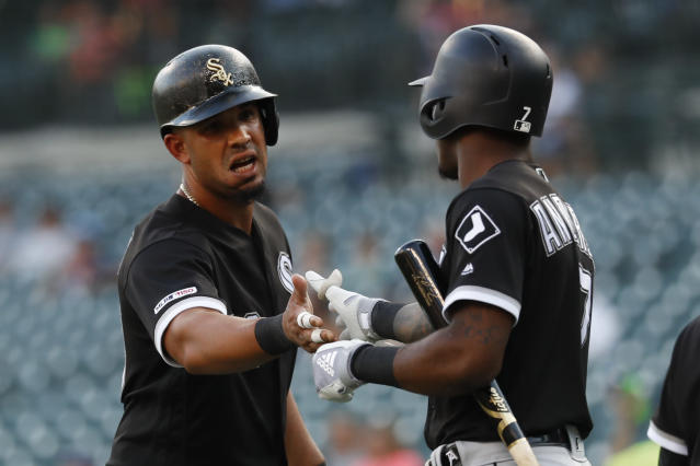 Chicago White Sox's Jose Abreu, left, celebrates with Tim Anderson after scoring on a Matt Skole two-run double against the Detroit Tigers in the first inning of a baseball game in Detroit, Monday, Aug. 5, 2019. (AP Photo/Paul Sancya)