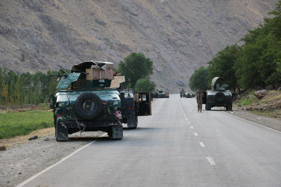 Afghan soldiers pause on a road at the front line of fighting between Taliban and Security forces, near the city of Badakhshan, northern Afghanistan, Sunday, July. 4, 2021. Officials said Sunday that the Taliban's march through northern Afghanistan has gained momentum with the capture of several districts from fleeing Afghan forces. They said that several hundred of them fled across the border into Tajikistan.(AP Photo/Nazim Qasmy)