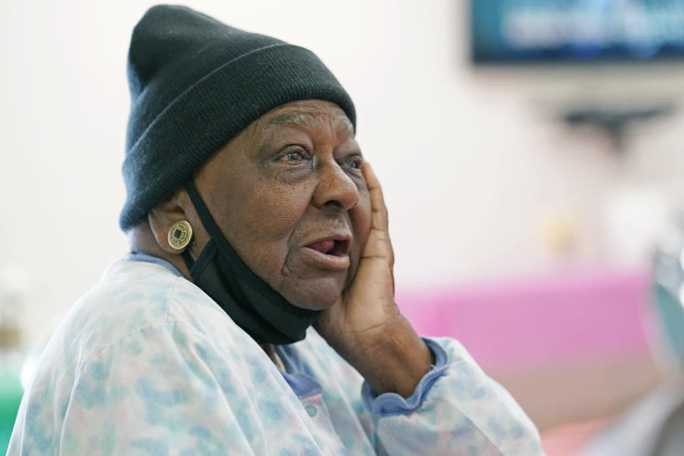 FILE - P.M. Browner, 88, speaks about her apprehension over receiving the COVID-19 vaccine, while waiting for a transportation bus at the Rev. S.L.A. Jones Activity Center for the Elderly to take her and other seniors to the Aaron E. Henry Community Health Service Center to receive a vaccination, in Clarksdale, Miss., in this April 7, 2021, file photo. New COVID-19 cases are declining across the most of the country, even in some states with vaccine-hesitant populations. But almost all states bucking that trend have lower-than-average vaccination rates, and experts warn that relief from the pandemic could be fleeting in regions where few people get inoculated. (AP Photo/Rogelio V. Solis, File)
