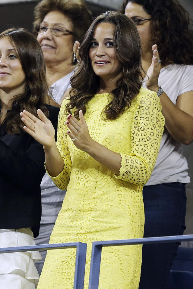 Pippa Middleton watches the quarterfinals match between Roger Federer, of Switzerland, and Tomas Berdych, of Czech Republic, at the U.S. Open tennis tournament, Wednesday, Sept. 5, 2012, in New York. (AP Photo/Darron Cummings)