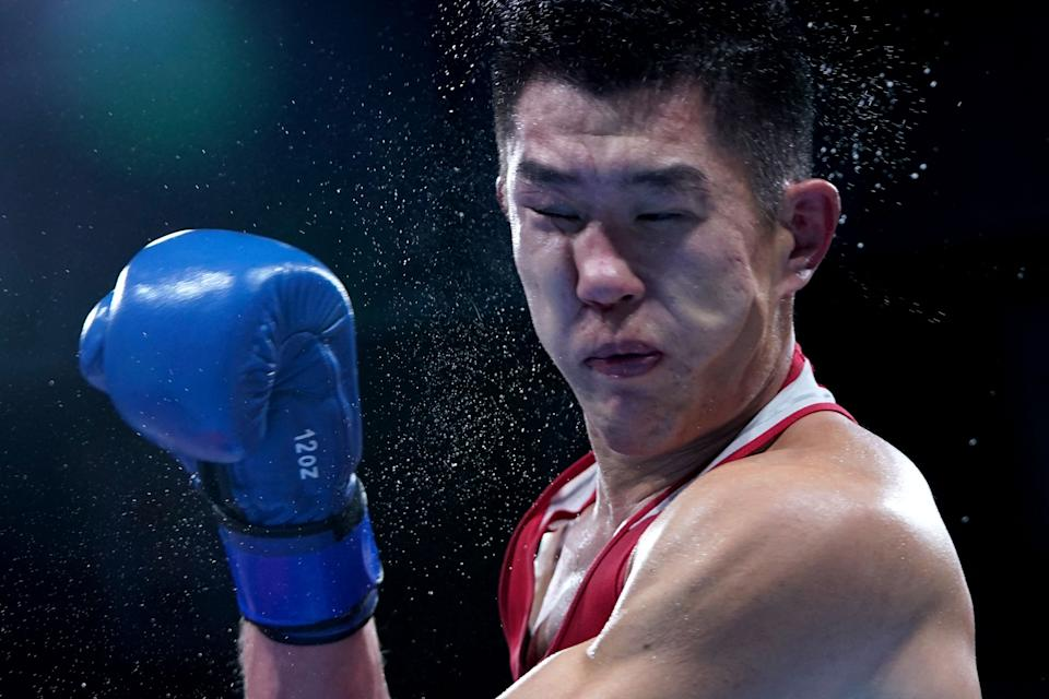 <p>Kazakhstan's Bekzad Nurdauletov (red) and Russia's Imam Khataev fight during their men's light heavy (75-81kg) preliminaries round of 16 boxing match during the Tokyo 2020 Olympic Games at the Kokugikan Arena in Tokyo on July 28, 2021. (Photo by Frank Franklin II / POOL / AFP)</p>
