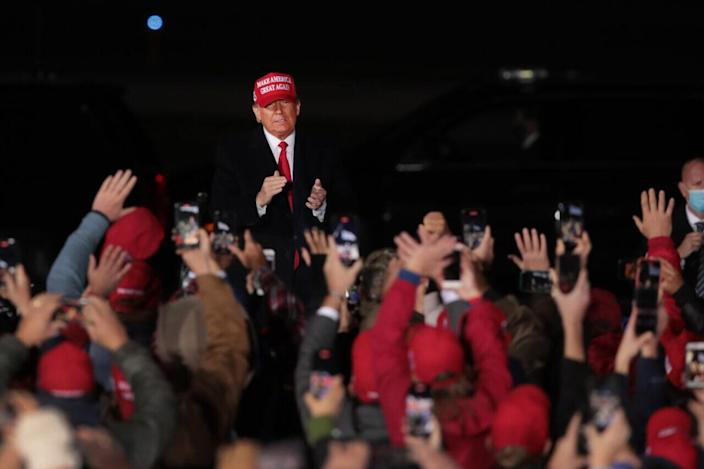 President Donald Trump arrives for a rally at the Southern Wisconsin Regional Airport on October 17, 2020 in Janesville, Wisconsin. (Photo by Scott Olson/Getty Images)