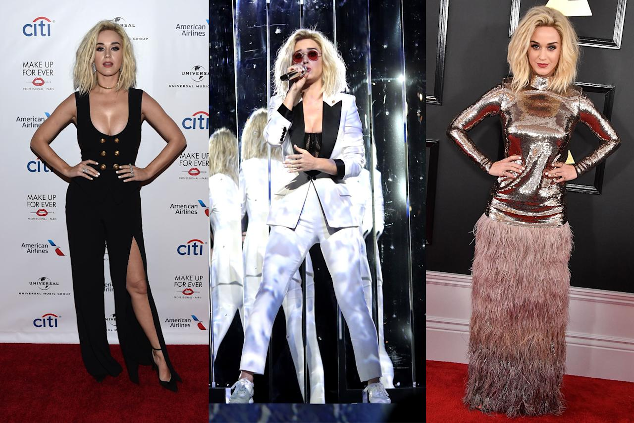 """<p>For the award show, Perry wore a gown from Tom Ford's fall 2016 ready-to-wear collection. She then switched into a white pantsuit from designer Ford — with a Planned Parenthood logo on the lapel — for her debut performance of her single """"Chained to the Rhythm."""" Her last outfit of the night was a black Zuhair Murad jumpsuit with button detailing that she wore while attending Universal Music Group's Grammy after-party. (Photos: Getty Images) </p>"""