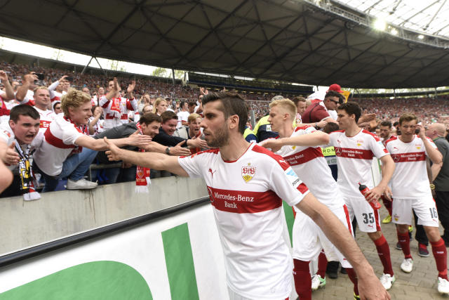 Soccer Football - Hannover 96 v VfB Stuttgart - 2. Bundesliga - HDI-Arena, Hannover, Germany - 14/5/17 Stuttgart's Emiliano Insua celebrates with fans after the match Reuters / Fabian Bimmer Livepic DFL RULES TO LIMIT THE ONLINE USAGE DURING MATCH TIME TO 15 PICTURES PER GAME. IMAGE SEQUENCES TO SIMULATE VIDEO IS NOT ALLOWED AT ANY TIME. FOR FURTHER QUERIES PLEASE CONTACT DFL DIRECTLY AT + 49 69 650050.