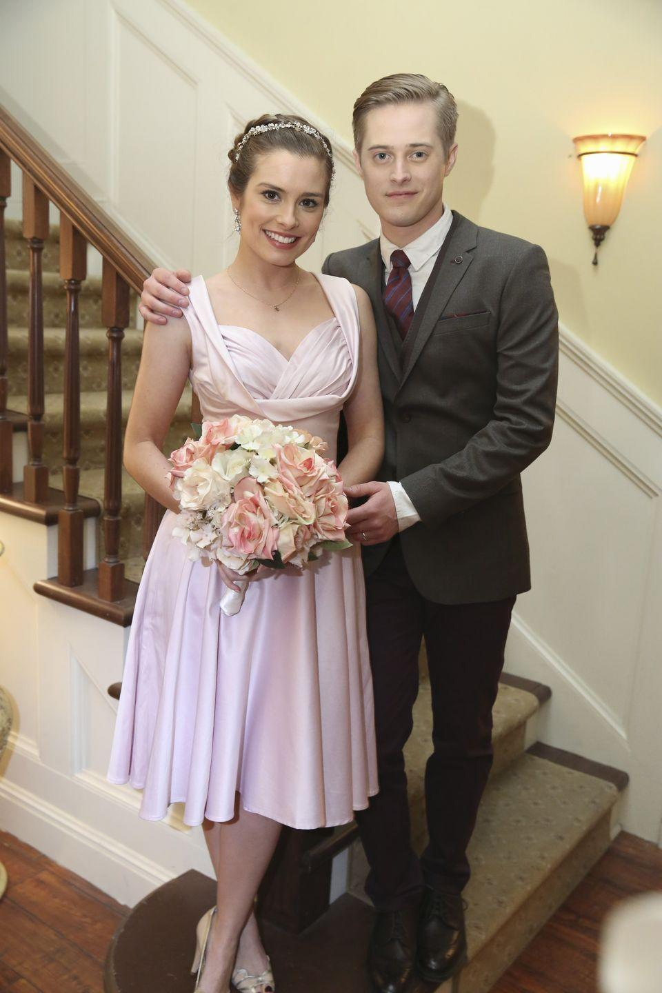 <p>For her surprise at-home wedding to Toby, Lily Summers kept her wedding look simple opting for a blush cross-neck tea-length dress and a crystal headpiece instead of the classic white dress. Toby's burgundy tie matched perfectly! </p>