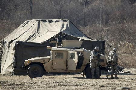 U.S. army soldiers take part in a military exercise at a training field near the demilitarized zone separating the two Koreas in Paju