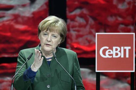 German Chancellor Angela Merkel speaks during the opening ceremony of the CeBit computer fair, which will open its doors to the public on March 20, at the fairground in Hanover, Germany, March 19, 2017.      REUTERS/Fabian Bimmer